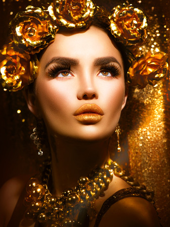 Golden holiday makeup. Golden wreath and necklace. Fashion art hairstyle and makeup