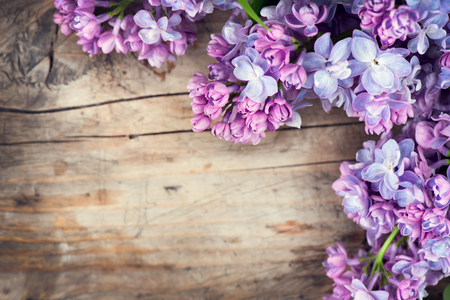table top: Lilac flowers bunch over wood background