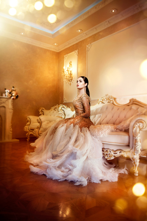 luxury room: Beauty gorgeous woman in beautiful evening dress in luxurious style interior room. Elegant lady full length portrait