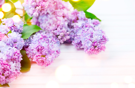 design: Lilac flowers bunch on white planks wood background