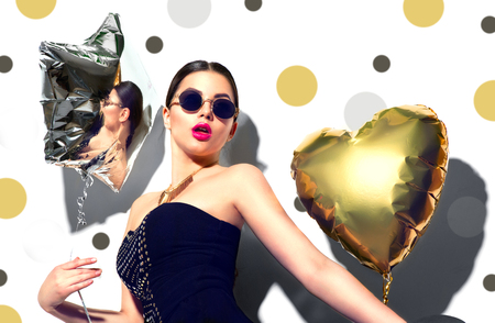 gold: Party. Beauty model girl with colorful heart and star shaped balloons isolated on white background Stock Photo