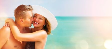 people: Middle aged couple enjoying romantic summer beach holidays. Travel and vacation concept Stock Photo