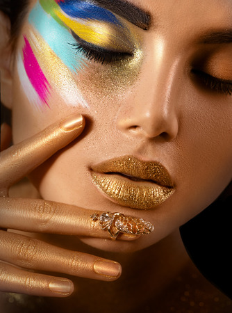 Beauty fashion art portrait of beautiful woman with colorful abstract makeup photo