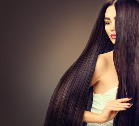 long: Beautiful brunette model girl with long straight black hair over dark background