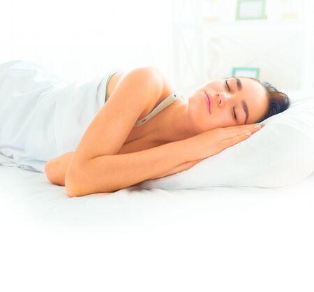 comfortable: Beauty brunette girl sleeping in her comfortable bed Stock Photo