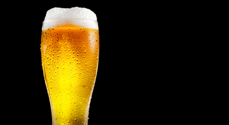 yellow: Beer. Glass of cold beer with water drops. Craft beer isolated on black background Stock Photo