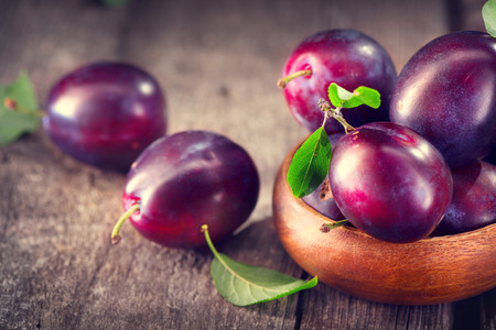 yellow: Plum. Juicy ripe organic plums closeup, over wooden background Stock Photo