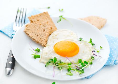 yellow: Healthy breakfast. Fried heart shaped egg closeup