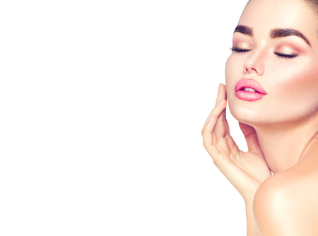 people: Beauty spa brunette woman touching her face. Skincare