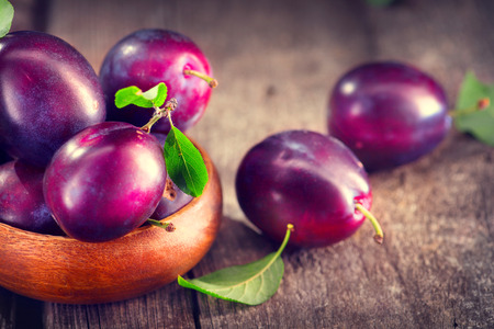 Plum. Juicy ripe organic plums closeup, over wooden background Reklamní fotografie