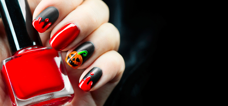 Halloween holiday manicure design ideas. Halloween nail art 免版税图像 - 88687846