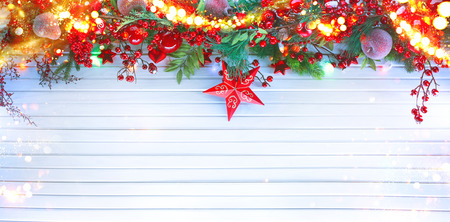 Christmas and New Year decoration over white wood background. Border art design