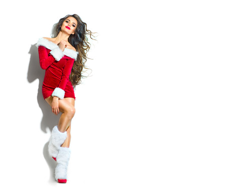 Christmas scene. Sexy Santa. Beauty model girl wearing red party costume