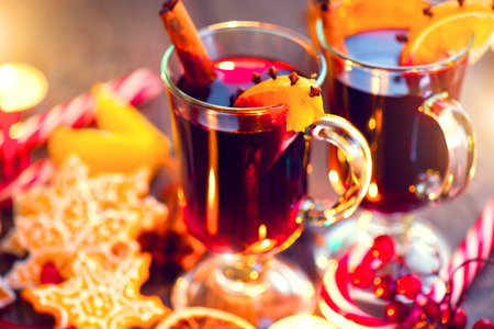 Christmas traditional mulled wine on holiday decorated table Stock Photo