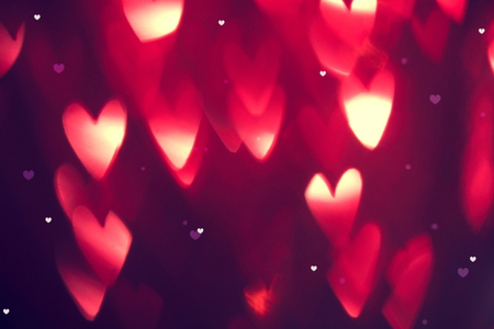 Valentines Day background. Holiday abstract background with red glowing hearts Stock Photo