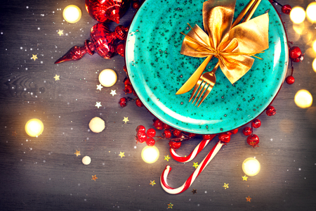 Christmas dinner table setting. Abstract holiday wooden background