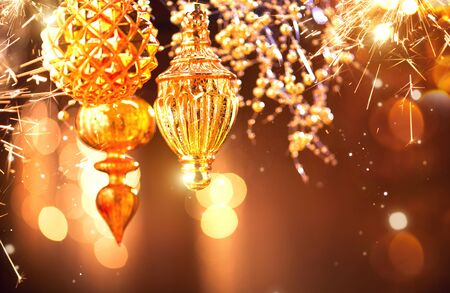 Christmas and New Year golden decorations closeup. Abstract blinking holiday background