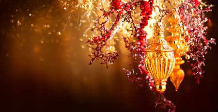 Christmas and New Year golden decoration. Abstract blinking holiday background