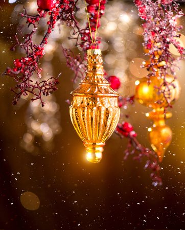 Christmas and New Year golden decorations. Abstract blinking holiday background