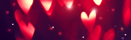 Valentines Day background. Holiday abstract background with red glowing hearts Banque d'images