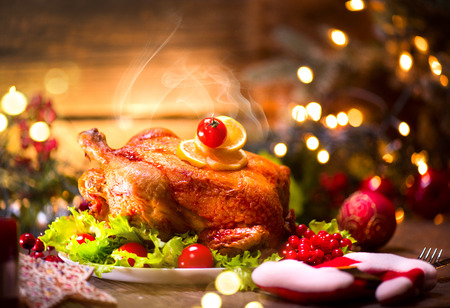 Christmas dinner. Decorated holiday table with roasted chicken