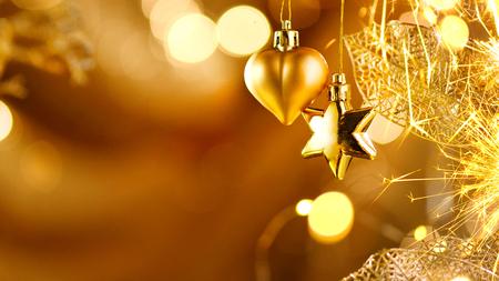 Décorations d'or de Noël et du nouvel an. Fond de vacances clignotant abstrait