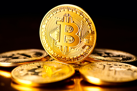 Bitcoin crypto currency. BTC coins on black background. Blockchain technology, Bitcoin mining concept Stock Photo