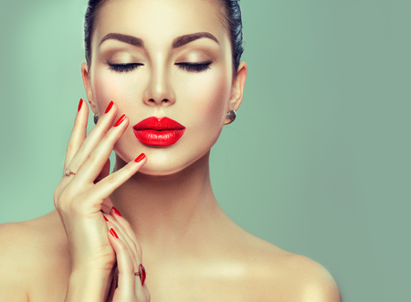 Beautiful fashion sexy woman with red lipstick and red nails