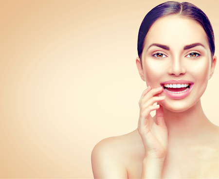 Beauty spa brunette woman touching her face. Skincare concept Stock Photo
