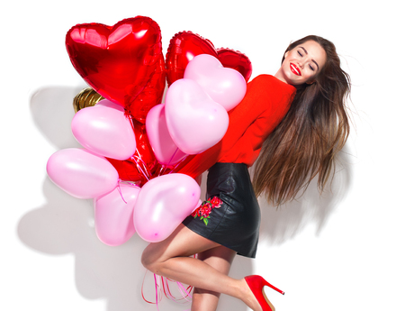 Valentine's Day. Beauty girl with colorful air balloons having fun, isolated on white background Фото со стока - 93518488