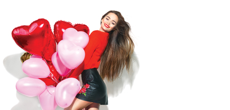 Valentines Day. Beauty girl with colorful air balloons having fun, isolated on white background