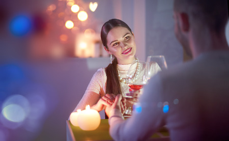 Romantic dinner. Young couple toasting wine glass in restaurant. Dating Stock Photo - 94046474