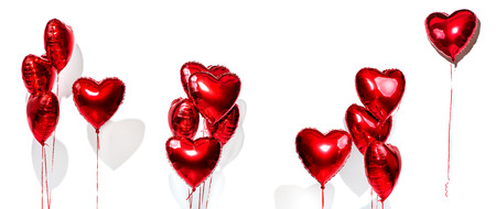Valentines Day. Set of air balloons. Bunch of red heart shaped foil balloons isolated on white background Stock Photo