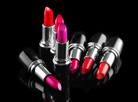 Lipstick. Professional makeup and beauty. Lipstick tints palette closeup. Colorful lipsticks over black background Banco de Imagens - 95303461