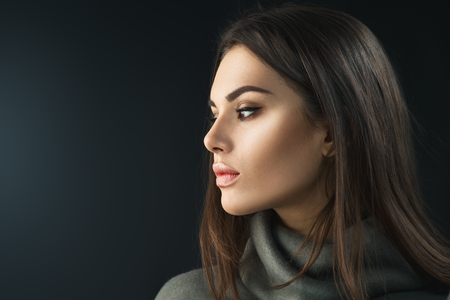 Fashion model brunette girl. Beauty portrait of young woman with professional makeup