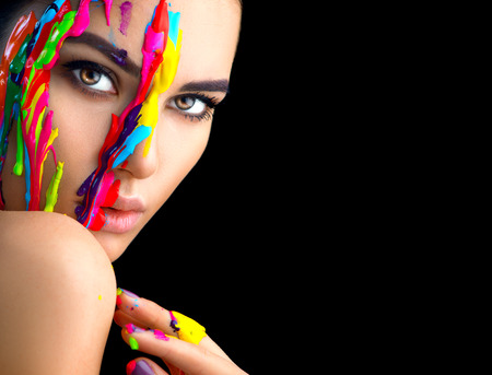 Beauty model girl with colorful paint on her face. Portrait of beautiful woman with flowing liquid paint isolated on black 免版税图像 - 94971057