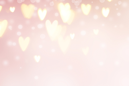 Valentine's Day background. Abstract glowing hearts on pink holiday backdrop