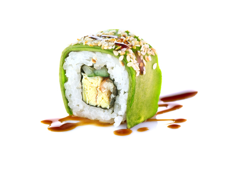Sushi roll over white background. Sushi roll with eel, tofu, vegetables and avocado closeup. Japanese food