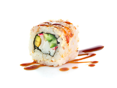Sushi roll isolated on white background. California sushi roll with tuna, vegetables and unagi sauce closeup 스톡 콘텐츠