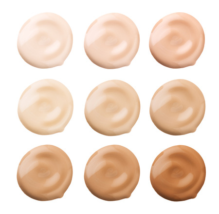 Foundation face makeup samples. Set of cosmetic liquid foundation or cream in different colour smudge smear strokes. Make up smears isolated on a white background. Foundation colors palette