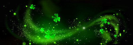 St. Patrick's Day. Green shamrock leaves over black background. Abstract holiday backdrop