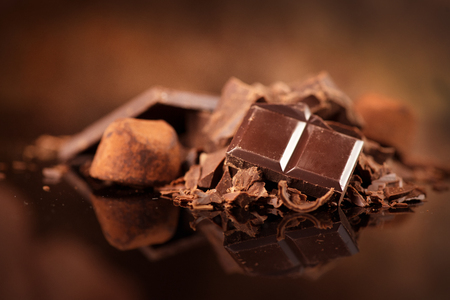 Chocolate. Assorted chocolate sweets and candies over dark background. Confectionery