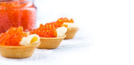 Salmon caviar. Tartlets with red caviar closeup. Gourmet food. Seafood. Trout caviar Stock Photo