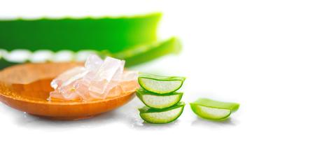 Aloe Vera gel closeup on white wooden background. Organic sliced aloevera leaf and gel, natural organic cosmetic ingredients for sensitive skin, alternative medicine. Skincare concept