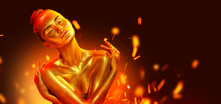 Golden skin woman portrait closeup. Sexy model girl with holiday golden shiny professional makeup over flame background. Golden metallic body 版權商用圖片