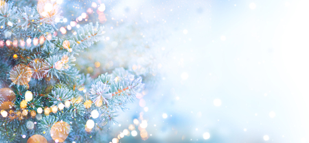 Christmas holiday tree decorated with garland lights. Border snow background. Snowflakes. Blue spruce, beautiful Christmas and New Year Xmas tree art design, abstract blue widescreen backdrop