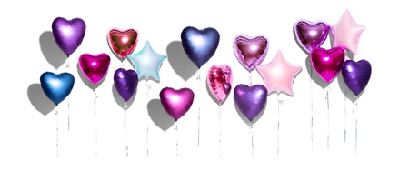 Air balloons. Bunch of purple heart shaped foil balloons, isolated on white background. Valentines day background