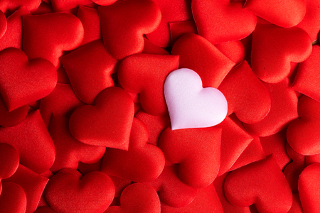 Valentine's Day. Holiday abstract red Valentine background with satin hearts. Love concept Banco de Imagens