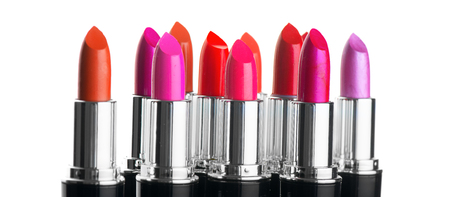 Lipstick tints palette. Fashion colorful lipsticks over white background. Professional makeup and beauty