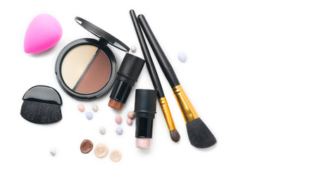 Face contouring makeup products over white. Highlight, shade, contour and blend. Make up artist tools Imagens
